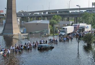 Residents flee New Orleans in the aftermath of Hurricane Katrina
