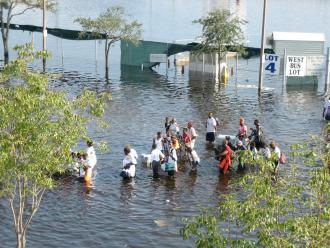 People attempting to flee New Orleans on foot after Hurricane Katrina struck