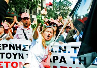 Greek workers march during a general strike last year