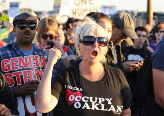 Demonstrators march on the Oakland docks on November 2