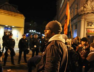 Oakland Occupiers watch as police again take over their encampment at Oscar Grant Plaza