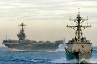 A U.S. aircraft carrier and guided missile destroyer  (Robert M. Cieri)