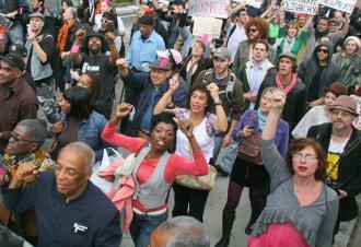 Occupy Wall Street demonstrators march across the Brooklyn Bridge in New York City (Brennan Cavanaugh)