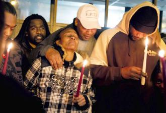 Friends and family hold a vigil for two teenagers shot in Chicago's Englewood neighborhood