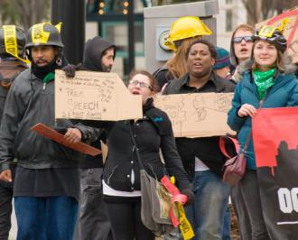 Occupy Charlotte marches against restrictive new laws criminalizing protest