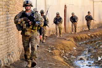 U.S. troops on patrol at a Department of Public Works facility and water distribution point in Kandahar