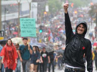 Québec students participate in a mass march in defiance of repressive laws