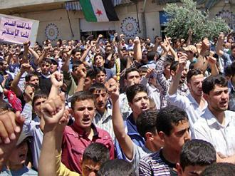 Protesters against the Assad regime march in Homs