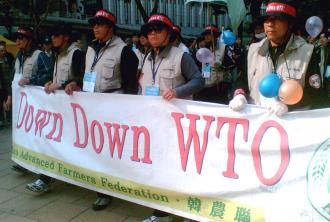 South Korean farmers protest a meeting of the World Trade Organization  (Janice Lo)