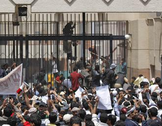 Protesters gather outside the U.S. embassy in Sanaa, Yemen