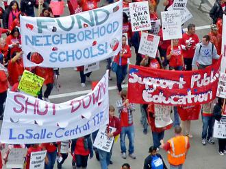 Chicago teachers march with supporters during their strike to defend quality public schools