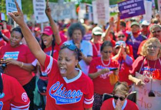 Chicago teachers march with thousands of supporters during their strike