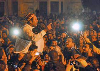 Anti-Morsi protesters massed outside the presidential palace in Cairo  (Jonathan Rashad)