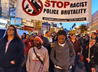 Kevin Clark (second from left) marches with activists against police brutality in the Mission (Steve Rhodes)