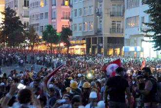 Democracy demonstrators fill Taksim Square at night (Burak Su)