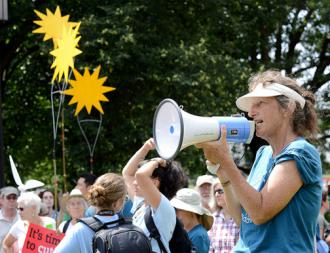 Climate change activists demand Obama block the Keystone XL pipeline at a Summer Heat rally outside the White House (Steven Melkisethian)