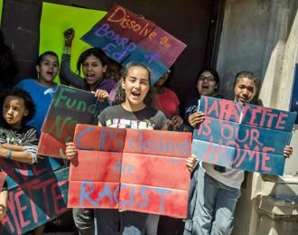 Students chant at the front doors of occupied Lafayette Elementary in Chicago (Sarah-ji)