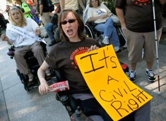 Protesters with ADAPT demand funding for Medicaid outside the White House in 2010