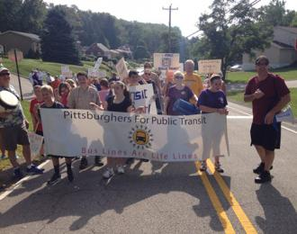 Marching to demand bus service in Baldwin (Molly Nichols)