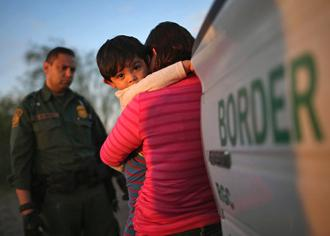 The U.S. Border Patrol detains a migrant mother and child