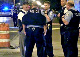 Chicago police huddle next to a crime scene