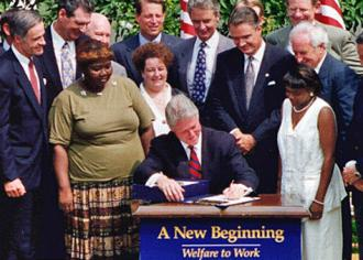 Bill Clinton signs welfare reform legislation into law (Wikimedia Commons)