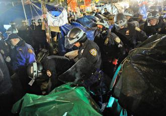 New York City police march through Zuccotti Park destroying the encampment