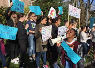 Middle and high school students across Seattle hit the streets to defy Trump's hateful agenda