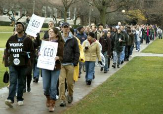Members of the Graduate Employees Organization and supporters on the march at UIUC (Chris Tuck)