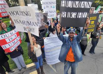 Demonstrators speak out for an affordable housing ordinance (Los Angeles Community Action Network)