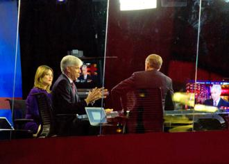 From left: Savannah Guthrie and David Gregory on the NBC News set with Brian Williams (Phil Davis)
