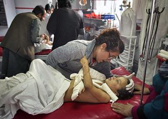 Doctors care for the victim in the bombed U.S. hospital in Kunduz