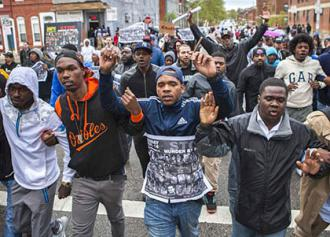 Demonstrators march for Freddie Gray in Baltimore