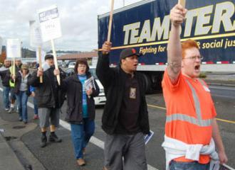UNFI strikers marching on the picket line