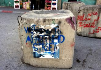 "In Hebron, graffiti artists have renamed Shuhana Street ""Apartheid Street"" (Bill Mullen 