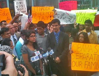 Nadia Habib (at the microphones) speaks at a press conference and rally, with supporters surrounding her (Danny Lucia | SW)