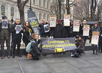 Protesters call for the Rikers Island jail to be shut down at a protest outside City Hall (Julian Guerrero | SW)