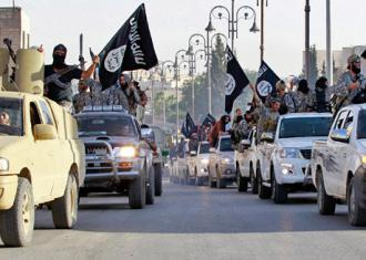 ISIS fighters riding in a convoy