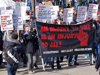 A contingent organized by the International Socialist Organization marching against union-busting in Madison