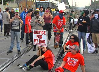 Protesters in Long Beach block a commuter train to demand justice (Sanchez Montebello)