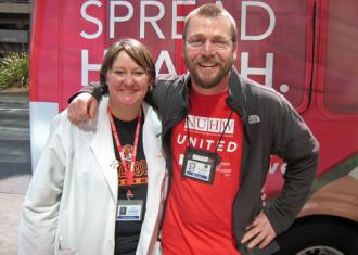 Kaiser workers and NUHW supporters Kekela Moberg (left) and Michael Turk (Carl Finamore)