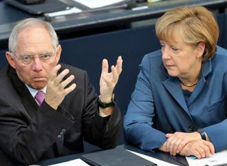 German Finance Minister Wolfgang Schäuble (left) with Chancellor Angela Merkel