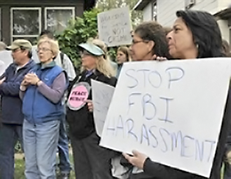 Minneapolis residents rally against an FBI raid on the homes of activists