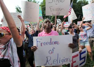 Some 500 people gathered for a hastily organized counter-protest against the attack on Muslims (Bill Steber | SteberPhoto.com)