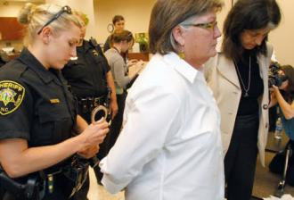 Marriage equality supporters are arrested after one demands a marriage license following passage of Amendment 1