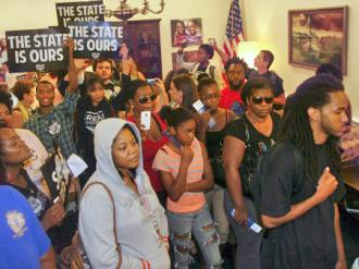 Dream Defenders flood into the hallway outside Gov. Rick Scott's office in the Florida state Capitol