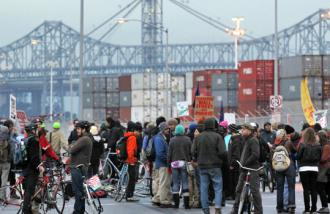 Protesters gathered in front of the gates to the Port of Oakland