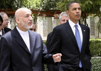 Barack Obama meets with Afghan President Hamid Karzai while on a visit to Afghanistan