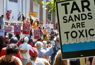 Hundreds of activists gathered in Burlington, Vt., in July 2012 to protest a pro-corporate conference for governors (Nolan Rampy | SW)