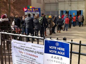 Waiting to cast a ballot in New York City where the aftermath of Hurricane Sandy disrupted voting